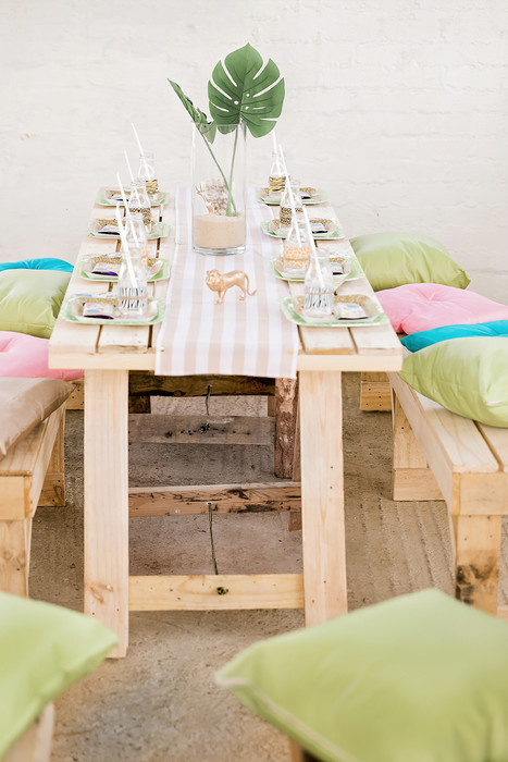 Rustic wooden table and benches with colour matching cushions and runners for hire.