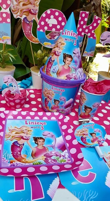 Our custom made Barbie in a mermaid tale party supplies include personalised pvc banners, party packs, movie boxes and more.