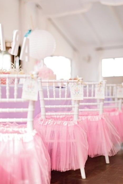 Kiddies tiffany chairs for hire with pink tutus to match the party theme.