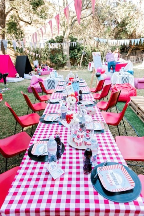 Retro steel and plastic chairs for hire, with fifties style table cloths,