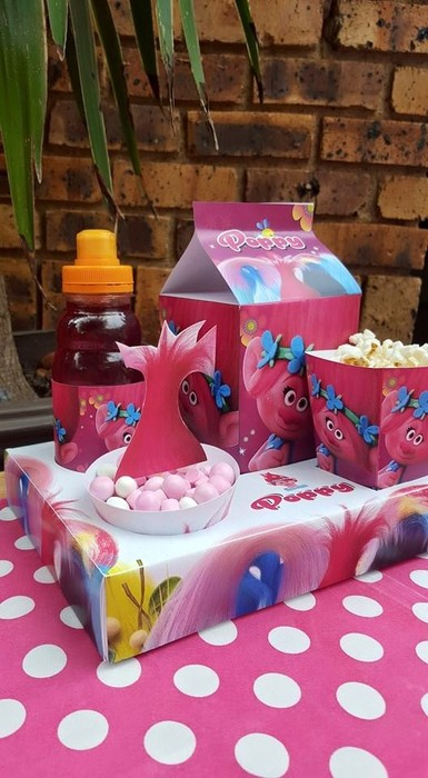 Our custom made Poppy Trolls party supplies include personalised pvc banners, party packs, movie boxes and more.