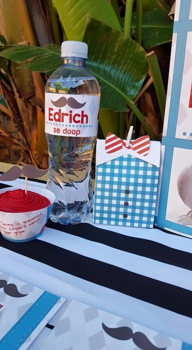 Our custom made Little Man party supplies include personalised invitations, paper cups and plates, blowouts and more.